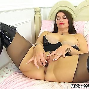 British milf Raven is pleasing her nyloned pussy