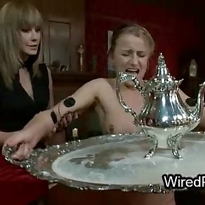 Trussed wired maid fucked by lesbians