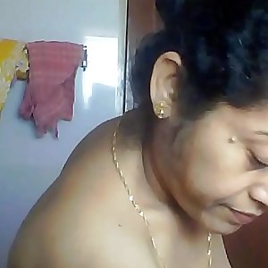 Sexy Mature Indian aunt spied in bathroom by neighbour getting ready for bath Part 2