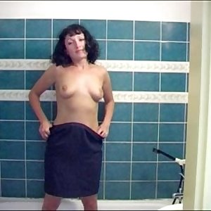 Beautiful russian brunette chick peeing in the shower