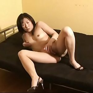 Asian wife wears only heels while playing her trimmed twat