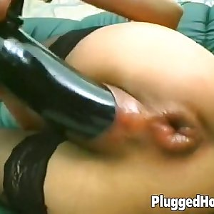 Chick fucks herself with a black faux-cock