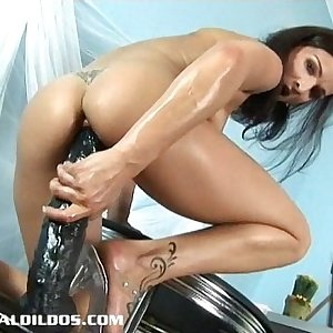 Petite European brunette filling her tight beaver with a giant faux-cock