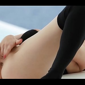 Cutie rubs pussy in a solo act