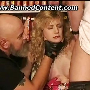 Lady getting tied on a chair in pornshop