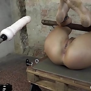 Hot brunette babe tied like a hog and fucked by machine